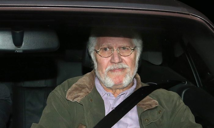 Dave Lee Travis arrives home after leaving Aylesbury police station near Leighton Buzzard, England, on Nov. 15, 2012. (Peter Macdiarmid/Getty Images)