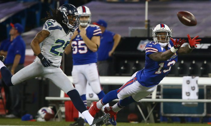Stevie Johnson #13 of the Buffalo Bills cannot get to an overthrown pass during an NFL game as Richard Sherman #25 of the Seattle Seahawks provides coverage at Rogers Centre on December 16, 2012 in Toronto, Ontario, Canada. (Tom Szczerbowski/Getty Images)
