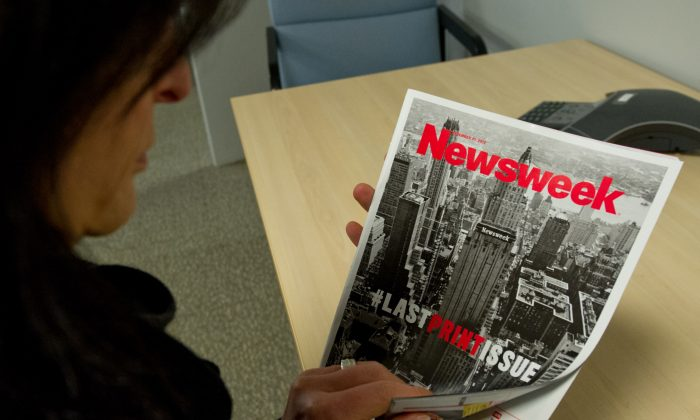 This December 24, 2012 photo shows a woman perusing the final print edition of Newsweek in Washington, DC. Newsweek ends its 80-year run as a weekly news magazine with a final print edition published this week with a December 31, 2012 date. (KAREN BLEIER/AFP/Getty Images)