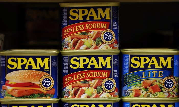 Cans of Spam are displayed on a shelf at Cal Mart grocery store in San Francisco, Calif., on Jan. 3, 2013. (Justin Sullivan/Getty Images)