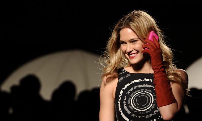 Model Bar Refaeli presents a creation by Desigual during the 080 Barcelona 'Autumn-Winter 2013-2014' fashion week in Barcelona on January 29, 2013. (Lluis Gene/AFP/Getty Images)