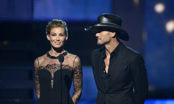 Singers Faith Hill and Tim McGraw speak onstage at the 55th Annual GRAMMY Awards at Staples Center on February 10, 2013 in Los Angeles, California. (Kevork Djansezian/Getty Images)