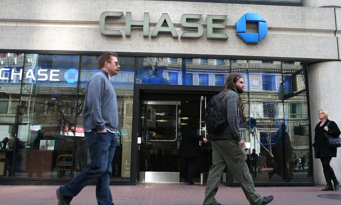 Pedestrians pass by a Chase Bank branch in San Francisco, Feb. 20, 2013. In the banking industry, the design and location of branches and the quality of customer service are important factors in building a leading brand.