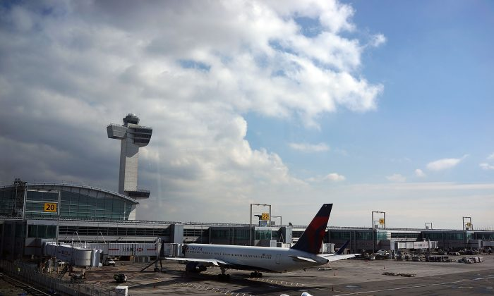 A plane waits at John F. Kennedy Airport on February 28 in New York City. A suspicious package with a strange odor was found by postal workers at the airport on Aug. 11. (Spencer Platt/Getty Images)