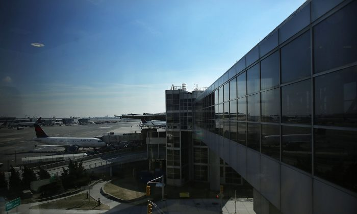 A plane waits at John F. Kennedy Airport on February 28, 2013 in New York City. (Spencer Platt/Getty Images)