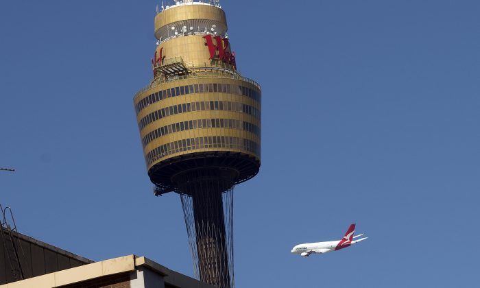 380 Airbus flies low over Sydney's CBD on March 11, 2013. Qantas has also been lobbying the Federal Government for a debt guarantee. (Saeed Khan/AFP/Getty Images)