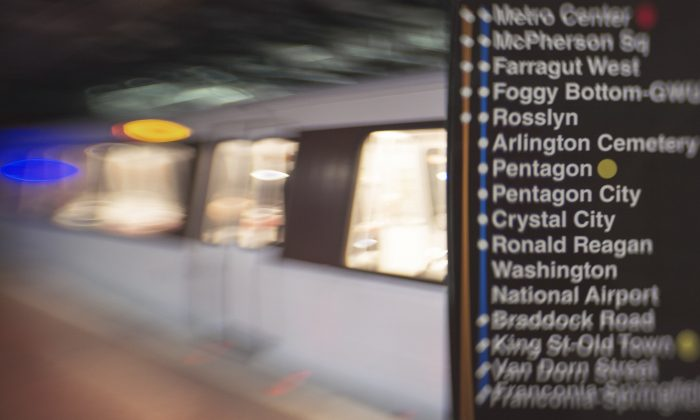This March 28, 2013 photo illustration shot with a perspective control lens shows a route guide inside the Washington, DC METRO system at the Metro Center station. (PAUL J. RICHARDS/AFP/Getty Images)