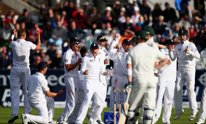 Stuart Broad (left) celebrates with his England team-mates after claiming the wicket of Brad Haddin at 7 for 181 runs during Day 4 of the fourth Ashes Test match against Australia at the Riverside Stadium in North-East England on Aug 12, 2013. With 118 runs needed to win, Australia were in deep trouble. England won by 74 runs. (Ryan Pierse/Getty Images)