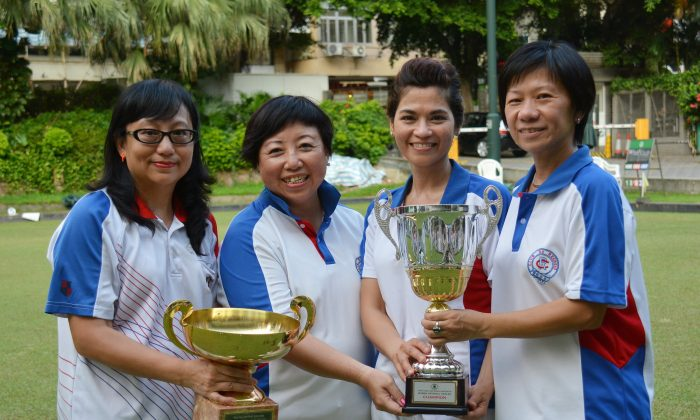 Champions ... (From left) Women's Singles champion Anna Chan and National Triples winners Rita Tong, Janet Ferreira and Celena Kwok from Club de Recreio proudly display their trophies after hard-fought victories in the finals. (Stephanie Worth)