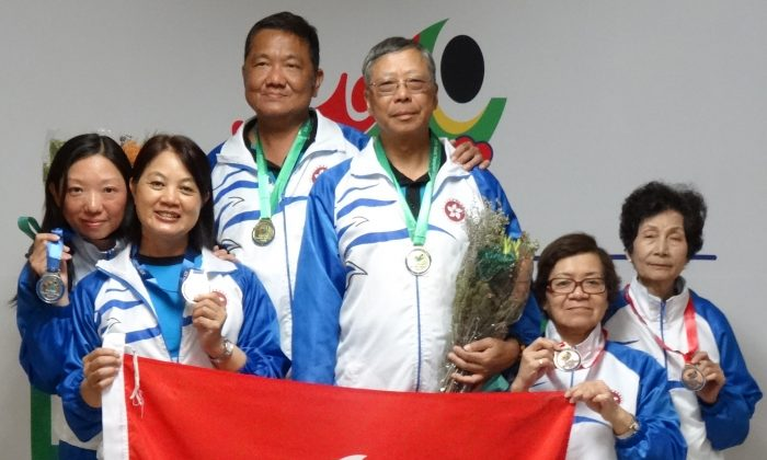 Happy team ... The Hong Kong team of (from left) Leung Fung Ling, Leung Yuk Chun, Chan Yeuk Pang, Lai Sui Lung, Fung Suk Ching and Leung Wai Ping proudly display their medals after the prize presentation ceremony of the XIX World Transplant Games in Durban, South Africa. (Ryan Cheung)