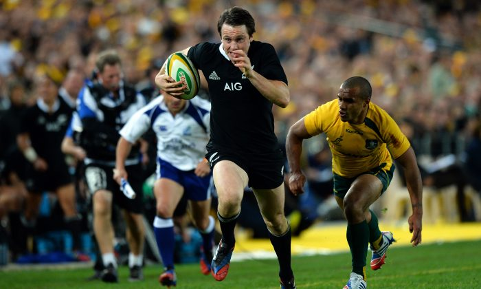 All Black wing Ben Smith evades Will Genia before scoring one of his three during the match against the Wallabies on Saturday Aug 17, 2013. (SAEED KHAN/AFP/Getty Images)
