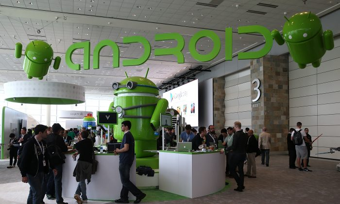 Attendees visit the Android booth during the Google I/O developers conference at the Moscone Center on May 15, 2013, in San Francisco, Calif. The Android mobile phone operating system is getting a major upgrade with Google releasing a security device manager that makes it easy to find the phone if lost or stolen or erase all its data. (Justin Sullivan/Getty Images)