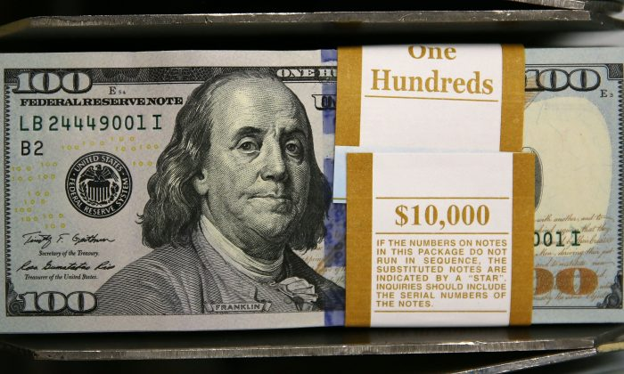 A $100 bill shows Benjamin Franklin, who was left-handed. (Photo by Mark Wilson/Getty Images)