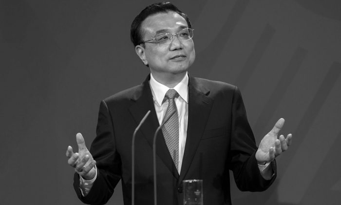 In this file photo, Chinese Prime Minister Li Keqiang gestures at a press conference on May 26, 2013, in Berlin, Germany. Li Keqiang's name has been attached to a package of economic reforms for China, which appear now to be falling apart. (Carsten Koall/Getty Images)