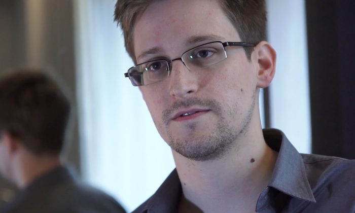 """In this handout photo provided by The Guardian, Edward Snowden speaks during an interview in Hong Kong. In an editorial in the state-run newspaper on August 8, 2013, China extolled Russia for seeing that the United States """"ate dirt"""" by granting asylum to the American headache and accused spy, Edward Snowden. (Photo by The Guardian via Getty Images)"""