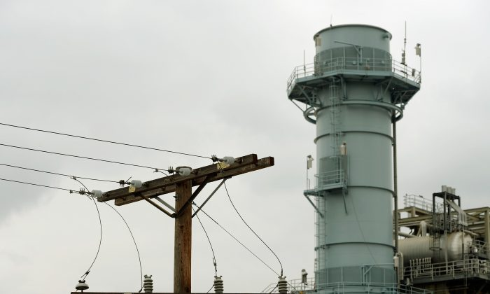 High voltage power lines are seen near a power plant in Burbank, Calif., June 24, 2013. Big banks are now facing big fines for electricity market manipulation in California, Arizona, Oregon, and Washington.  (Kevork Djansezian/Getty Images)