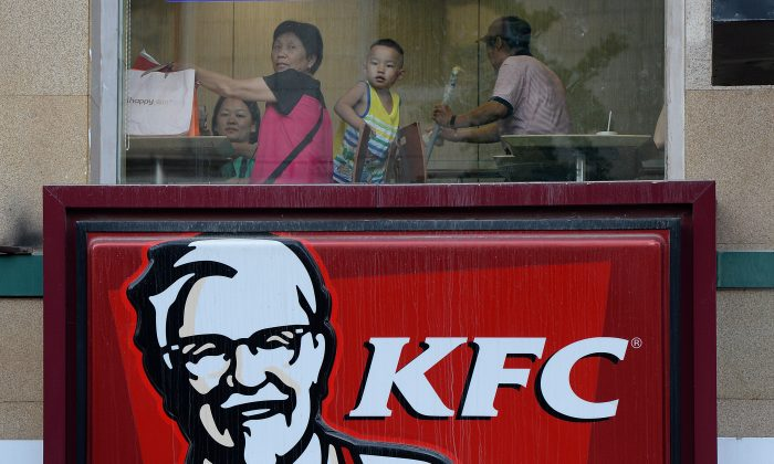 Customers dine at a KFC restaurant in Beijing on July 24, 2013. (MARK RALSTON/AFP/Getty Images)