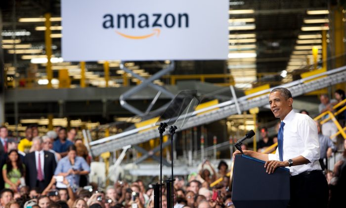U.S. President Barack Obama makes a speech about the economy and jobs at an Amazon.com Fulfillment Center July 30, 2013 in Chattanooga, Tennessee. While the 5000 direct jobs created are good news, a recent report suggests they will destroy more jobs at traditional retailers. (McGowan/Getty Images)