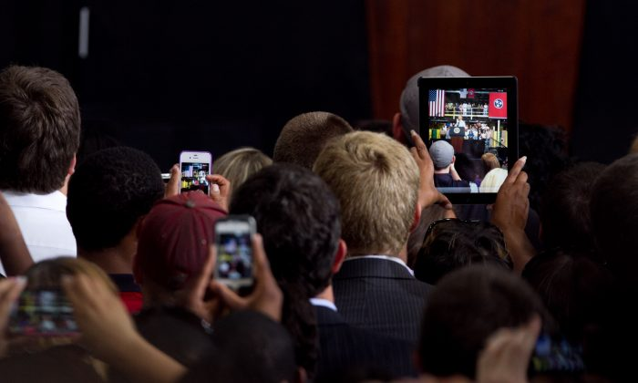 Amazon employees film and photograph President Obama in Chattanooga, Tennessee on July 30, 2013. Today, people are hooked on their smartphones and it's time for your business to make use of this habit.