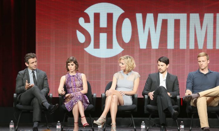 Celebrities speak at the CBS, Showtime and The CW portion of the 2013 Summer Television Critics Association on July 30, 2013 in Beverly Hills, California. Time Warner Cable has threatened to cut popular CBS content from its network as CBS wants more money for transmission rights. A careful look at each companies numbers shows that neither has to remain firm in its position.