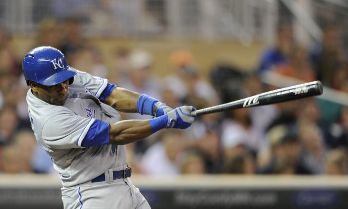 Miguel Tejada, seen at bat here in July 2013, will be suspended for using amphetamines. (Hannah Foslien/Getty Images)