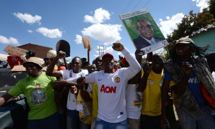 Supporters of Robert Mugabe's ZANU-PF party celebrate his recent election victory in Mbare, Zimbabwe, on Aug. 4. (Alexander Joe/AFP/Getty Images)
