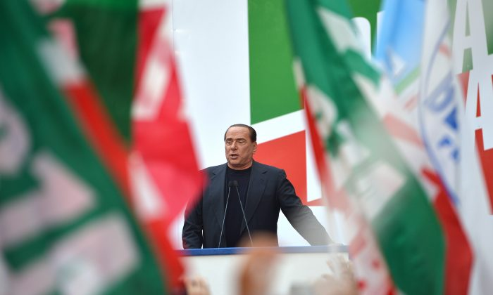 Former Italian Premier Silvio Berlusconi at a demonstration in Rome, Aug. 4. (GABRIEL BOUYS/AFP/Getty Images)