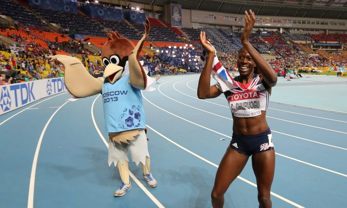 Christine Ohuruogu of Great Britain celebrates winning gold in the Women's 400 metres final during Day Three of the 14th IAAF World Athletics Championships Moscow 2013 at Luzhniki Stadium on August 12, 2013 in Moscow, Russia. (Photo by Ian Walton/Getty Images)