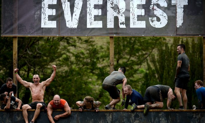 Participents take part in the Tough Mudder endurance event at Dalkieth Country Estate.  (Jeff J Mitchell/Getty Images)
