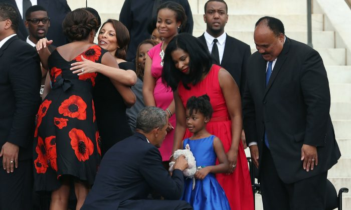 President Barack Obama greets Yolanda King, daughter of Martin Luther King III (R), and his wife, Arndrea King (2nd-R), as they commemorate the 50th anniversary of the March on Washington in Washington, D.C., Aug. 28. (Mark Wilson/Getty Images)