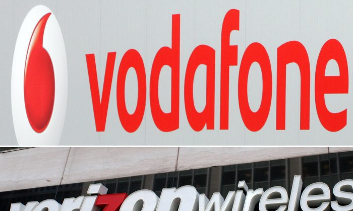 This Aug. 29 photo montage shows the logo for Verizon Wireless in Washington, D.C., in 2010 and the logo of British cellular provider Vodafone in Hanover, Germany, in 2007. (HAILEY SAYEGH,JOHN MACDOUGALL/AFP/Getty Images)