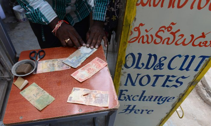 Indian rupee notes at a street stall in Hyderabad on August 29, 2013. India's and other emerging markets currencies and stock markets have suffered major losses in 2013.