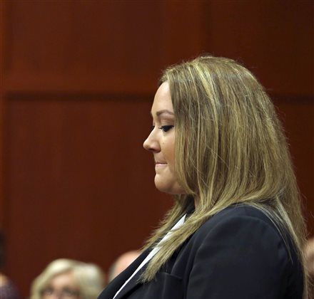 Shellie Zimmerman, wife of George Zimmerman, appears at the Seminole County Courthouse in Sanford, Fla. on Wednesday, Aug. 28, 2013. (AP Photo/Orlando Sentinel, Gary W. Green, Pool)