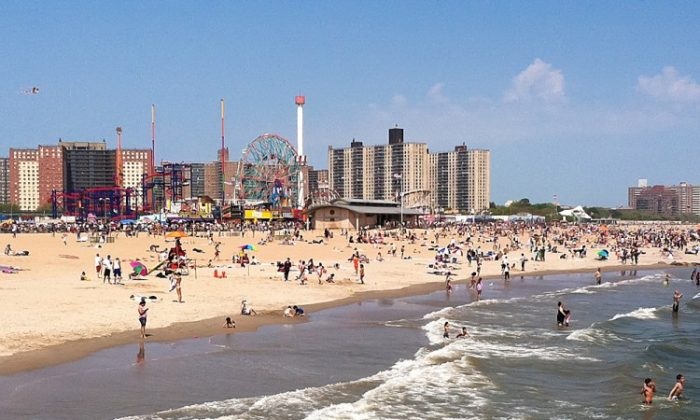 Beach goers enjoy a day in the sun at New York's Coney Island. (Kristen Meriwether/Epoch Times)