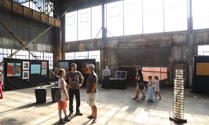 Visitors of the Urban Air Market enjoy the atmosphere in the old workshop building at Pier 70 in the  Dogpatch Neighborhood in San Francisco, Calif., on Aug. 18, 2013. (Christian Watjen/Epoch Times)