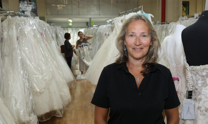 Candy Kantor, co-owner of RK Bridal, stands in her Manhattan store on W 39th Street, New York City, Aug. 28, 2013. (Christian Watjen/Epoch Times)