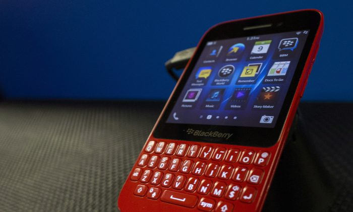 A BlackBerry Q5 on display at the company's Annual and Special Meeting in Waterloo, Ontario, Tuesday, July 9, 2013. (The Canadian Press/Geoff Robins)