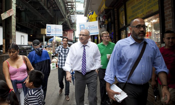 Democratic mayoral candidate Sal Albanese (center) is flanked by members of his campaign while walking down Roosevelt Avenue on August 1, 2013 in Queens, New York.  Few people recognize the political independent, who is considered a longshot at this point in the mayor's race, leading up to the September 10 primary. (Samira Bouaou/Epoch Times)