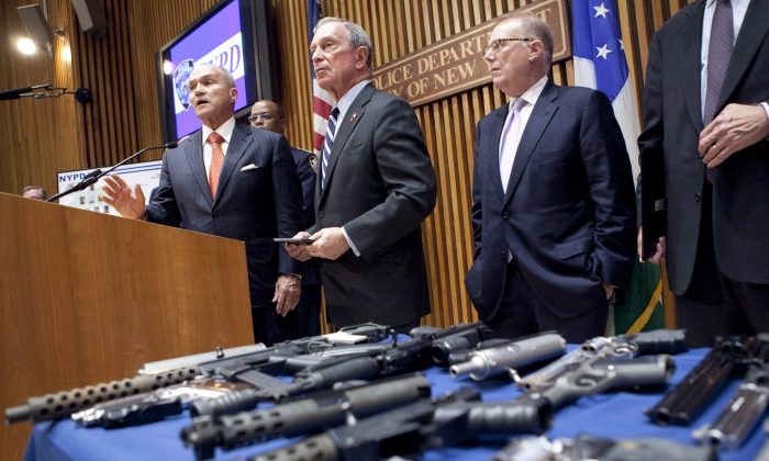 Mayor Michael Bloomberg and NYPD Commissioner Ray Kelly (3rd from L) at One Police Plaza where they announced the largest seizure of illegal guns in New York City history, Aug. 19. (Samira Bouaou/Epoch Times)