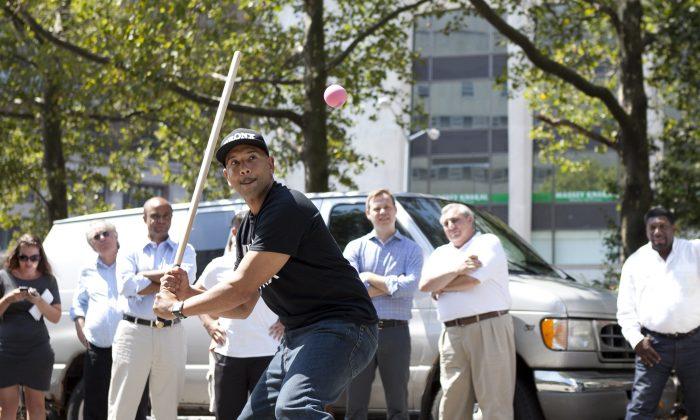 Bronx Borough President Ruben Diaz Jr. wins a stickball contest near Brooklyn Borough Hall, New York City, Aug. 27, 2013. (Samira Bouaou/Epoch Times)