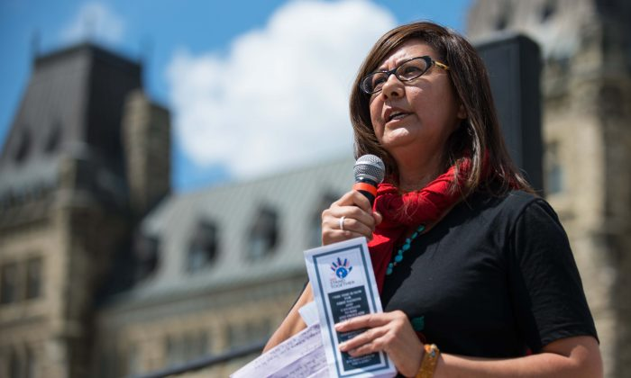 Brenda Sayers of Hupacasath First Nation speaks during a rally on Parliament Hill on Aug. 11. (Matthew Little/Epoch Times)