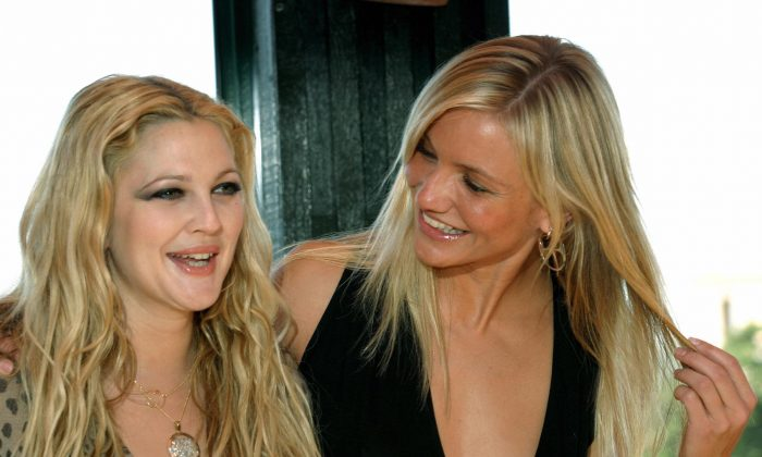 """Actresses Cameron Diaz (R) and Drew Barrymore are friends. They are also costars in the movie """"Charlie's angels-Full Throttle."""" Diaz and Barrymore pose on the roof of an central Rome hotel during a photo call on July 3, 2003. (Tiziana Fabi/AFP/Getty Images)"""