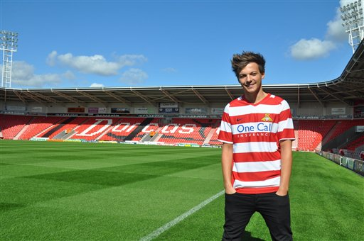 This is an undated handout photo issued by Doncaster Rovers FC via PA of Louis Tomlinson of One Direction who has signed with the English soccer team. (AP Photo/ Steve Uttley/PA)