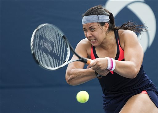 Marion Bartoli, of France, returns the ball against Magdalena Rybarikova, of Slovakia, during the Rogers Cup women's tennis tournament Thursday, Aug. 8, 2013, in Toronto. (AP Photo/The Canadian Press, Nathan Denette)