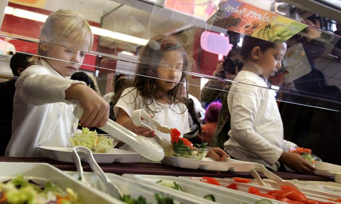 Students at Nettelhorst Elementary School in Chicago Illinois, on lunch, dig into a salad bar in the school's lunchroom in this file photo. (Tim Boyle/Getty Images)
