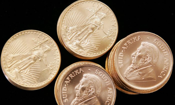 American Eagle and South African Krugerrand gold bullion are offered for sale at the Chicago Coin Company May 11, 2006. Gold prices have had a volatile 2013, baffling investors. (Photo Illustration by Scott Olson/Getty Images)
