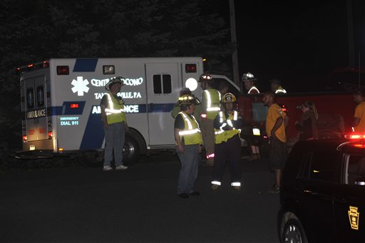 Emergency crews respond to a reported shooting at the Ross Township building, Monday, Aug. 5, 2013 in Saylorsburg, Pa.   (AP Photo/Chris Post)