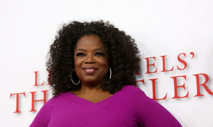 "Oprah Winfrey arrives at the Los Angeles premiere of ""Lee Daniels' The Butler"" at the Regal Cinemas L.A. Live Stadium 14 on Monday, Aug. 12, 2013. (Photo by Matt Sayles/Invision/AP)"