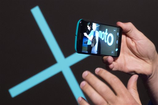The video capability of a Motorola Moto X smartphone, using Google's Android software, is shown, Thursday, Aug. 1, 2013 at a press preview in New York. (AP Photo/Mark Lennihan)