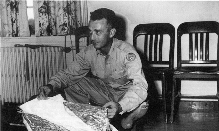 Major Jesse Marcel from the Roswell Army Air Field with debris found 75 miles north west of Roswell, NM, in June 1947. The debris has been identified as that of a radar target. United States Air Force/AFP/Getty Images)